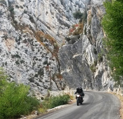 Motor-cyclists looking back in awe. Does he realize he has just biked around the fault plane of a thrusted anticline?!